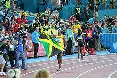 Asafa Powell of Jamaica with Flag
