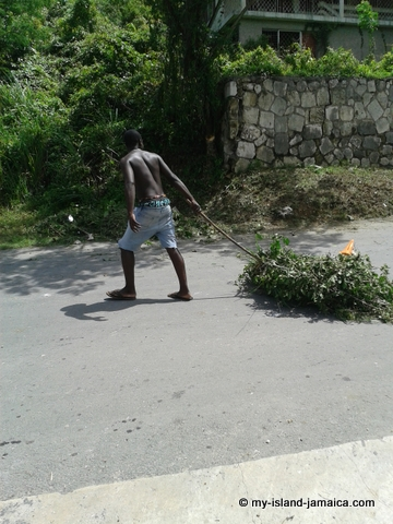Jamaican Youth Moving Debri