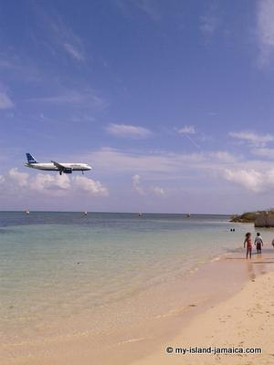 Plane Passing Overhead At Dead End Beach