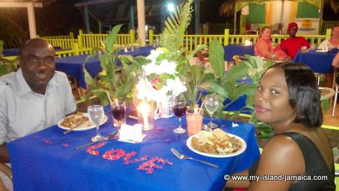 jamaican couple having_dinner_at_fun_holiday_beach_hotel