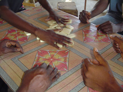 Jamaican Domino Players shuffle hands