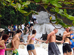 visitors climbing dunns river falls