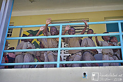education_in_jamaica_school_children_waving