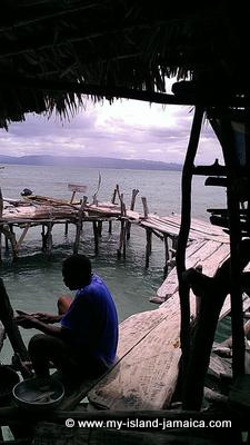 Cleaning fish for our lunch at Pelican Bar
