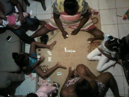 Jamaican Christmas- Playing Domino