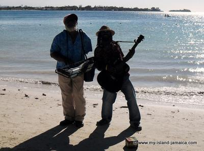 Jamaican men playing instruments on beach