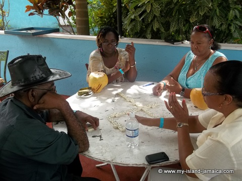 Jamaican ladies playing dominoes at Tapioca Village Retreat