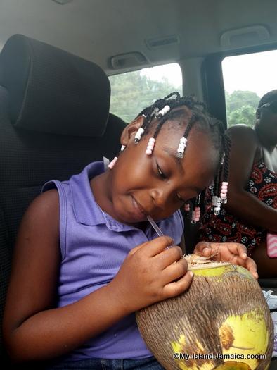 jamaican_maroon_charlestown_visit_aliana_gayle_enjoying_coconut