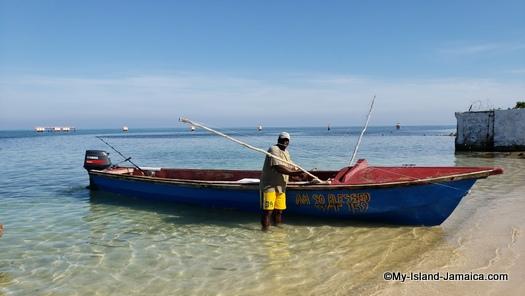 jamaican beach day - fishermen passing