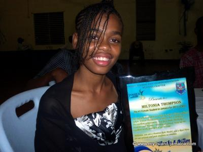 Miltonia Thompson Poses With Her Award