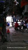 Boat drivers playing dominos at Pelican Bar while tourist play