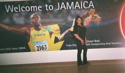 Lolita, at the Airport, posing next to Usain Bolt's poster