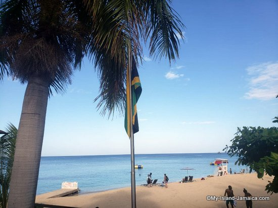 why_persons_visit_jamaica_flag_and_beach?