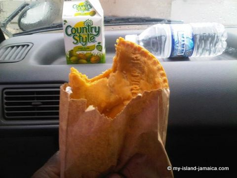 jamaican beef patty with drink- eating
