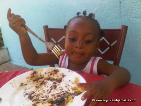 aliana_gayle_enjoying_her_jamaican_food_at_wag_water_valley_mothers_day_brunch