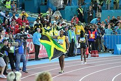Asafa Powell of Jamaica with Flag