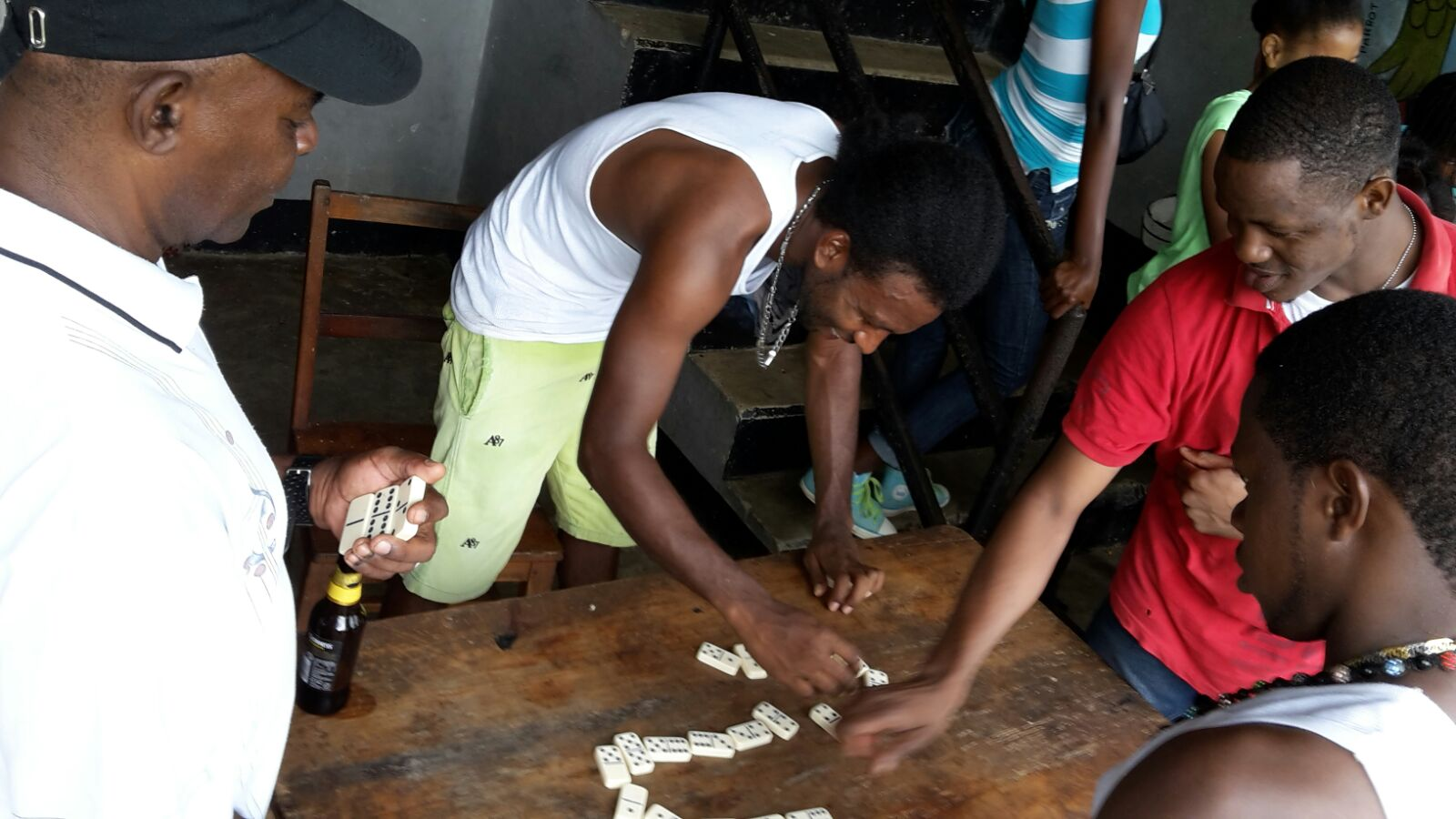cricket team socializing over a game of domino at barneyside westmoreland jamaica