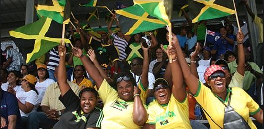 jamaican celebrations - ladies waving flag