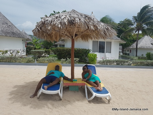 what to do in Jamaica - wellesley and wife sitting on beach at club decameron