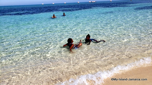 jamaican beach day - kids playing in water